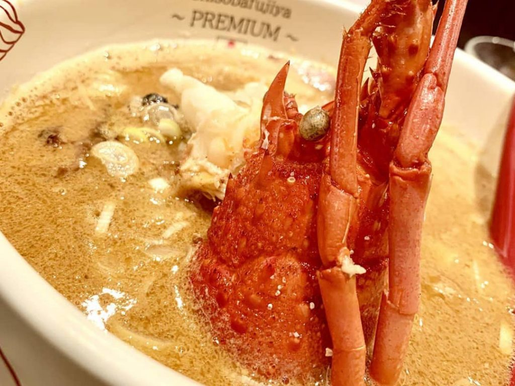 An image of a lobster in a sea of ramen broth from Onisoba Fujiya ramen shop in Shibuya, Tokyo